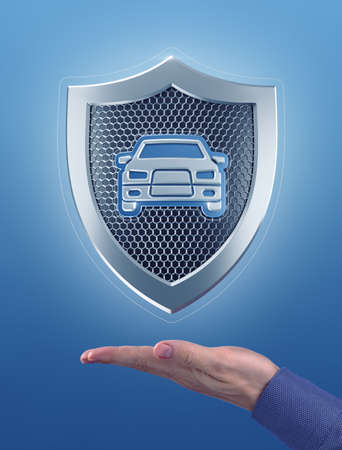 Car Security. Metallic shield with a car pictogram, which are hanging in the air above the faced up palm of a male hand. Photo-and-graphic composition, created from photo and 3D-rendering graphics.