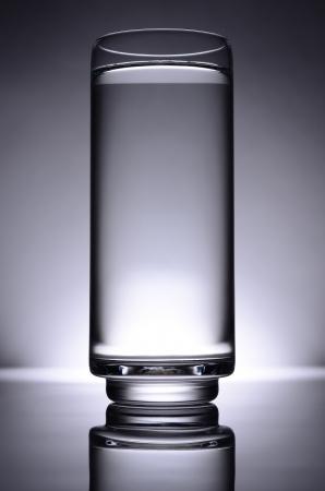glass of water, spot light in dark