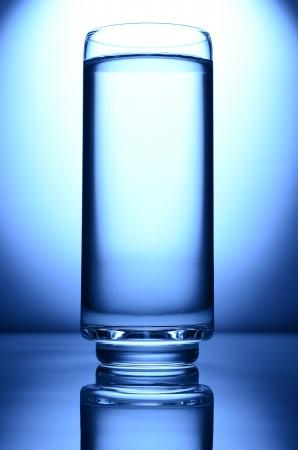 glass of water spot light blue