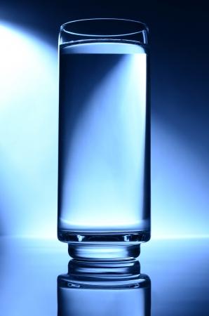 glass of water spot light blue photo