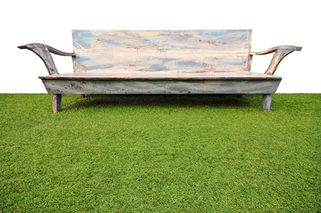 antique wood bench on green