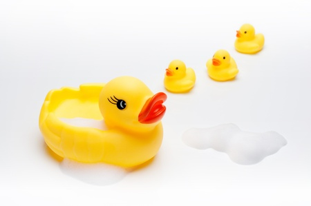 Yellow duck with babies in bathroom