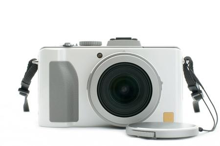 Fehér fényképezőgép - nyílt sapka