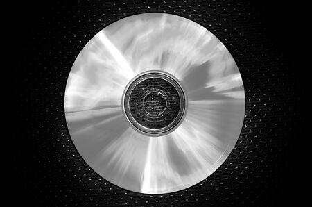 a CD on texture background-light silver