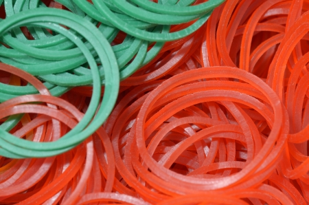 rubberband: close up of colourful rubber bands - green red