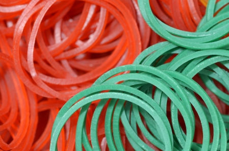 close up of colourful rubber bands - green red