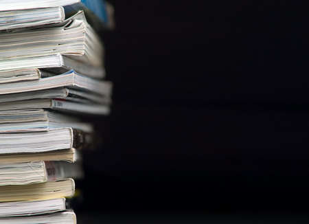Magazines Stack. Black background. Stock Photo - 4362122