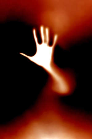nowhere: a white blured hand from nowhere Stock Photo