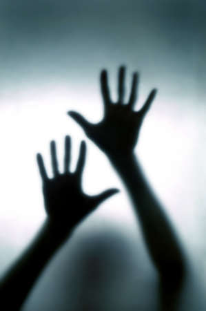 paranormal: A blurred  hands pressed glass Stock Photo