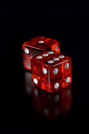 dice: Two dices on a black background. Focus on a first dice. Stock Photo