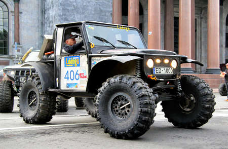 proto: SAINT PETERSBURG, RUSSIA - MAY 25  Vansovics Edvins Juris s off-road vehicle Jeep CJ-7 No 406 competes at the annual Ladoga Trophy Challenge on May 25, 2013 in Saint Petersburg, Russia  Editorial