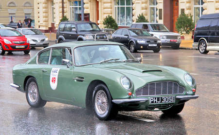 MOSCOW, RUSSIA - JUNE 3  English motor car Aston Martin DB6 competes at the annual L U C  Chopard Classic Weekend Rally on June 3, 2012 in Moscow, Russia