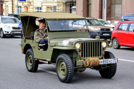 mb: MOSCOW, RUSSIA - JUNE 2  American command car Willys MB competes at the annual L U C  Chopard Classic Weekend Rally on June 2, 2013 in Moscow, Russia