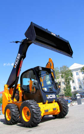 skid steer loader: UFA, RUSSIA - MAY 22  JCB skid steer loader presented at the annual International exhibition  Gas  Oil  Technologies  on May 22, 2012 in Ufa, Bashkortostan, Russia  Editorial
