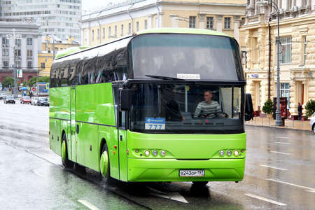 MOSCOW, RUSSIA - JUNE 3, 2012  Green Neoplan N1116 Cityliner interurban coach at the city street
