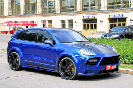 MOSCOW, RUSSIA - JULY 7, 2012  Blue sportscar Porsche 958 Cayenne tuned by Mansory at the city street