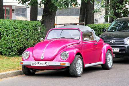 custom car: MOSCOW, RUSSIA - JULY 7, 2012  Pink Volkswagen Beetle custom car at the city street