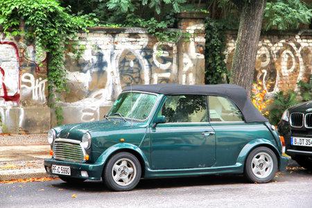 BERLIN, GERMANY - SEPTEMBER 12, 2013  Green Austin Mini Cooper Cabrio retro vehicle at the city street