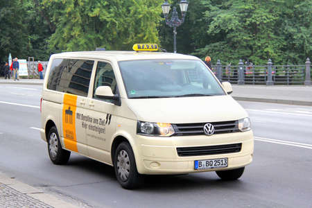 BERLIN, GERMANY - SEPTEMBER 12, 2013  Yellow Volkswagen Caravelle taxi at the city street