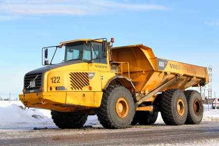 NOVYY URENGOY, RUSSIA - MARCH 5, 2014  Yellow Volvo A35D articulated dump truck at the city street