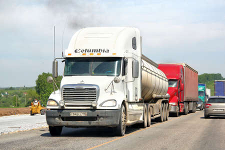 freightliner: TATARSTAN, RUSSIA - MAY 29, 2013  White Freightliner Columbia semi-trailer truck at the interurban road