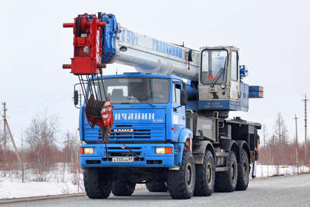 NOVYY URENGOY, RUSSIA - APRIL 23, 2013: Blue KAMAZ 6560 mobile crane at the interurban road.