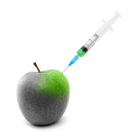 putrefied: Syringe stuck in an apple isolated over white background