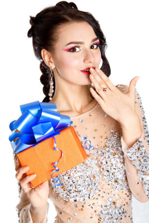 Beautiful young woman with a bright gift isolated over white background photo