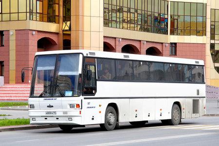 intercity: NOVYY URENGOY, RUSSIA - AUGUST 15, 2012: White MAZ 152 interurban coach at the city street.