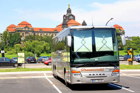 chamber of the engine: DRESDEN, GERMANY - JULY 20, 2014: Grey touristic coach Setra S416GT-HD at the city street.