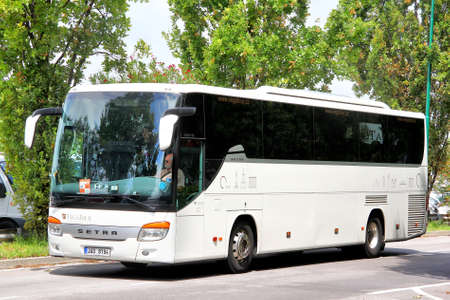 intercity: VENICE, ITALY - JULY 30, 2014: White interurban coach Setra S415GT-HD at the city street near the touristic bus station.
