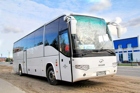 intercity: NOVYY URENGOY, RUSSIA - AUGUST 26, 2012: White Higer KLQ6129Q interurban coach at the city street. Editorial