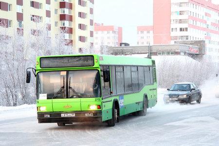 NOVYY URENGOY, RUSSIA - NOVEMBER 28, 2012: Green MAZ 103 city bus at the city street.