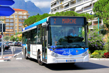 menton: MENTON, FRANCE - AUGUST 2, 2014: White and blue Heuliez GX127 city bus at the city street. Editorial
