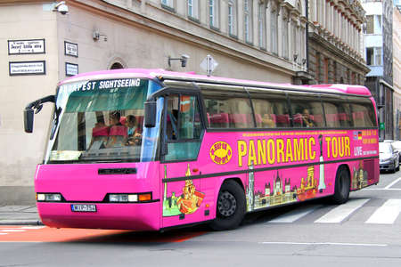 jetliner: BUDAPEST, HUNGARY - JULY 23, 2014: Pink city sightseeing bus Neoplan N216 Jetliner at the city street.