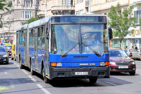 BUDAPEST, HUNGARY - JULY 25, 2014: Blue articulated city bus Ikarus 435.06 at the city street. Editorial