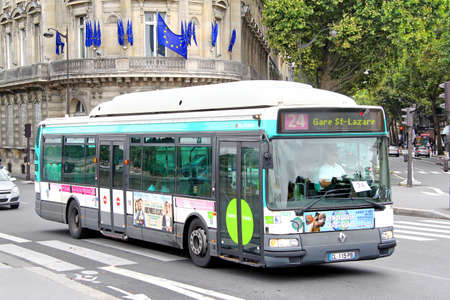 coach bus: PARIS, FRANCE - AUGUST 8, 2014: City bus Renault Agora S GNV at the city street. Editorial