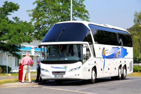intercity: BRANDENBURG, GERMANY - JULY 20, 2014:  White luxury intercity coach Neoplan N52173SHD Starliner at the parking near the interurban freeway. Editorial