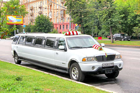 russian car: MOSCOW, RUSSIA - JULY 7, 2012: White Lincoln Navigator wedding limousine at the city street. Editorial