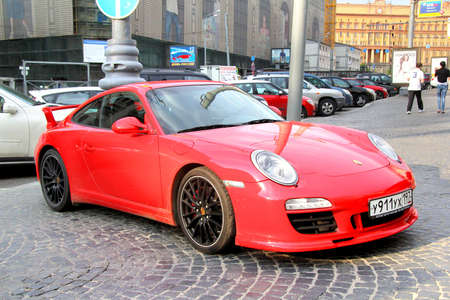 MOSCOW, RUSSIA - JUNE 2, 2013: Red Porsche 997 911 sportscar at the city street.