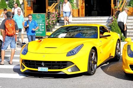 MONTE CARLO, MONACO - AUGUST 2, 2014: Yellow sports car Ferrari F12 Berlinetta near the casino.