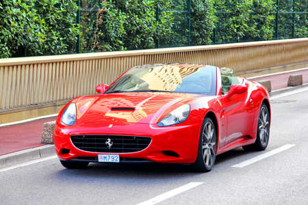 roofless: MONTE CARLO, MONACO - AUGUST 2, 2014: Red sports car Ferrari California at the city street. Editorial