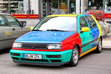 DRESDEN, GERMANY - JULY 20, 2014: Funny retro car Volkswagen Golf Harlekin at the city street.