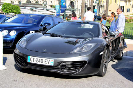 supercar: MONTE CARLO, MONACO - AUGUST 2, 2014: Black supercar McLaren MP4-12C at the city street near the casino. Editorial