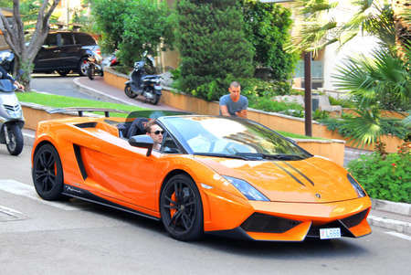 supercar: MONTE CARLO, MONACO - AUGUST 2, 2014: Orange supercar Lamborghini Gallardo Spyder at the city street.