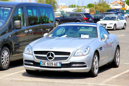 silver sports car: SAINT-TROPEZ, FRANCE - AUGUST 3, 2014: Silver sports car Mercedes-Benz R172 SLK-class at the city street. Editorial