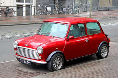 AMSTERDAM, NETHERLANDS - AUGUST 10, 2014: Retro car Austin Mini Cooper at the city street.