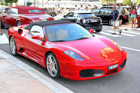ferrari: MONTE CARLO, MONACO - AUGUST 2, 2014: Red italian supercar Ferrari F430 Spider at the city street near the casino.
