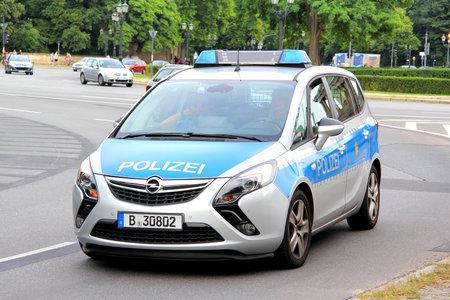 BERLIN, GERMANY - AUGUST 15, 2014: Modern police car Opel Zafira Tourer at the city street.