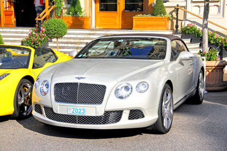 silver sports car: MONTE CARLO, MONACO - AUGUST 2, 2014: British luxury car Bentley Continental GTC at the city street near the casino.